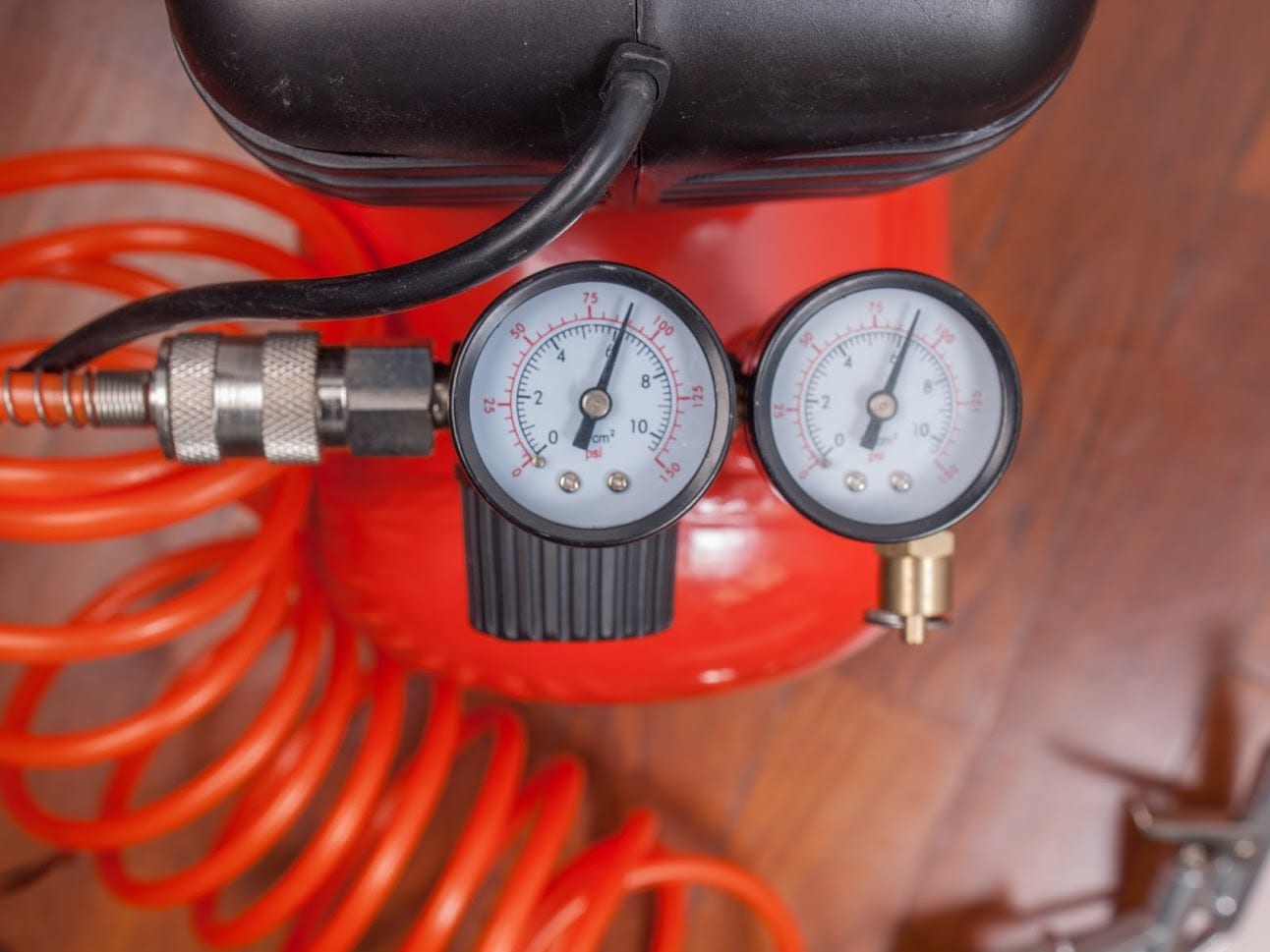 Detail of air compressor with manometer to measure air pressure